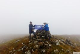 Флаг ПКО РГО-ОИАК побывал на высочайшей вершине Приморья – горе Аник